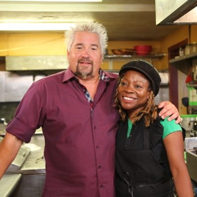 "Guy Fieri, host of the TV show ""Diners, Drive-Ins and Dives"" with Claudette, owner of Spice Island Grill"